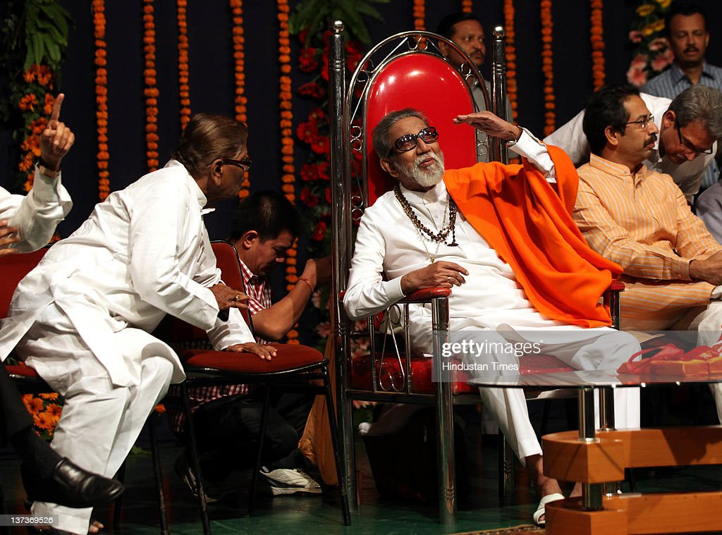 Shivsena chief Balasaheb Thackeray (C) chats during the party workers meeting before upcoming civic elections at Bandra on January 18, 2012 in Mumbai, India. Ten municipal councils and 27 district councils of Maharashtra are preparing for an election in February.