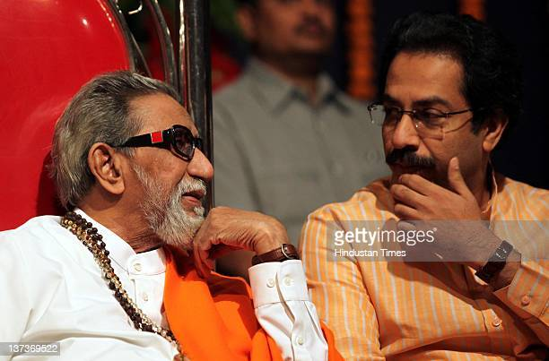 Shivsena chief Balasaheb Thackeray chats with executive president Uddhav Thackeray during the party workers meeting before upcoming civic elections...