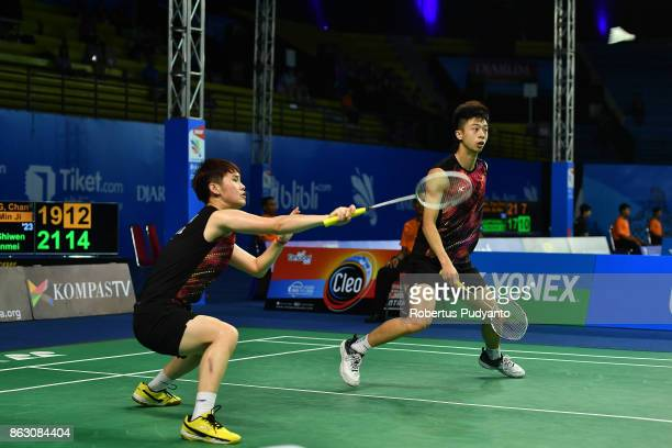 Shiwen Liu and Li Wenmei of China compete against Wang Chan and Kim Min Ji of Korea during Mixed Doubles Round 16 match of the BWF World Junior...