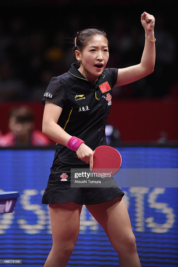 Shiwen Liu of China celebrates a point against Sayaka Hirano of Japan during day eight of the 2014 World Team Table Tennis Championships at Yoyogi National Gymnasium on May 5, 2014 in Tokyo, Japan.