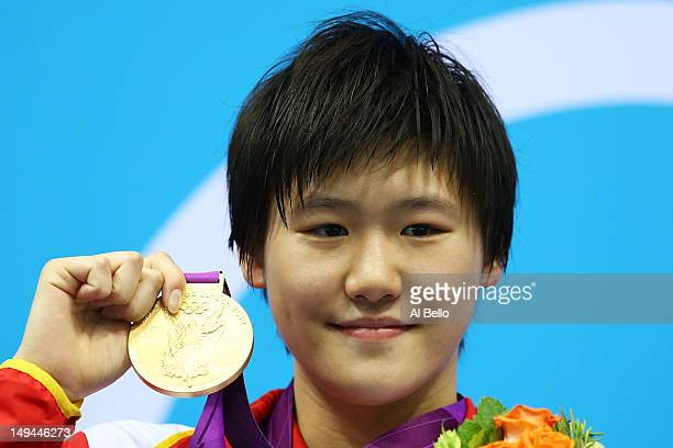 Shiwen Ye of China celebrates with her gold medal during the Medal Ceremony for the Women's 400m Individual Medley on Day 1 of the London 2012...