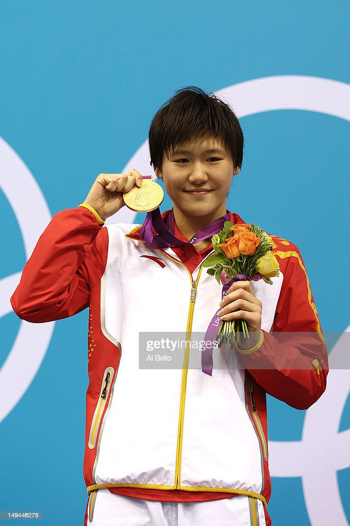 Shiwen Ye of China celebrates with her gold medal during the Medal Ceremony for the Women's 400m Individual Medley on Day 1 of the London 2012 Olympic Games at the Aquatics Centre on July 28, 2012 in London, England.
