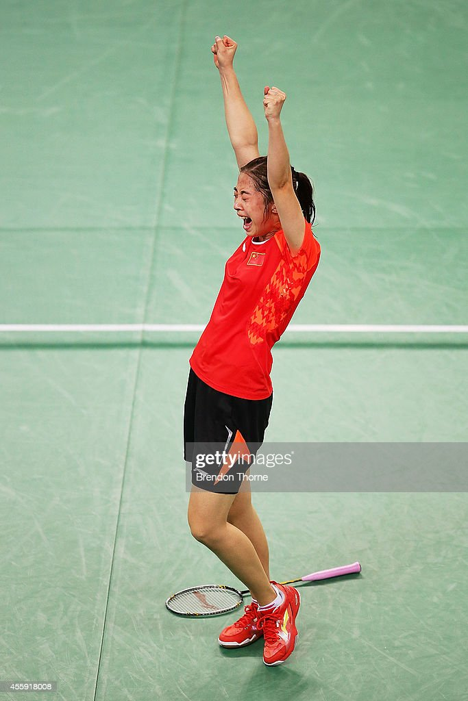 Shixian Wang of China celebrates match point to claim the Gold Medal for China in the Women's gold medal match during day three of the 2014 Asian Games at Gyeyang Gymnasium on September 22, 2014 in Incheon, South Korea.