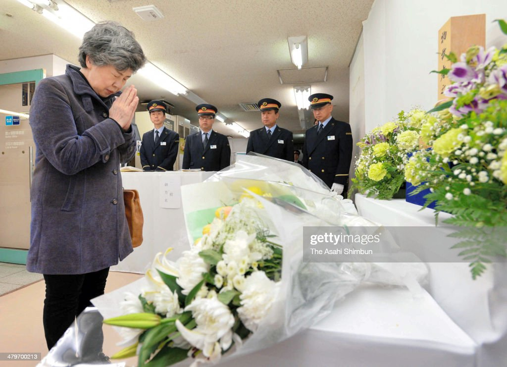 Shizue Takahashi, who lost her husband and Kasumigaseki station assisitant stationmaster while rescuing commuters, bows at a altar to commemorate the victims of the subway nerve gas attack at Tokyo Metro Kasumigaseki station on March 20, 2014 in Tokyo, Japan. Japan marks the 19th anniversary of the multiple chemical terrorist attack by Japanese doomsday cult Aum Shinrikyo, happened almost same time on the five subway lines at the morning commuter peak hours, killing 13 people.