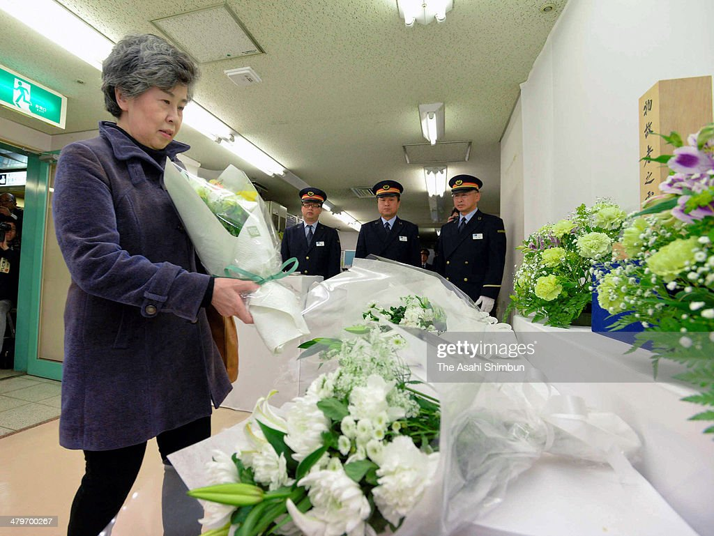 Shizue Takahashi, who lost her husband and Kasumigaseki station assisitant stationmaster while rescuing commuters, offer a flwoer bunch at a altar to commemorate the victims of the subway nerve gas attack at Tokyo Metro Kasumigaseki station on March 20, 2014 in Tokyo, Japan. Japan marks the 19th anniversary of the multiple chemical terrorist attack by Japanese doomsday cult Aum Shinrikyo, happened almost same time on the five subway lines at the morning commuter peak hours, killing 13 people.
