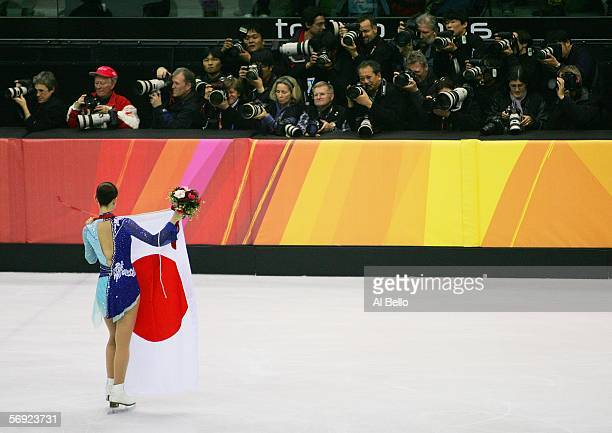 Shizuka Arakawa of Japan poses for photographers with her gold medal and her nations flag after the women's Free Skating program of figure skating...