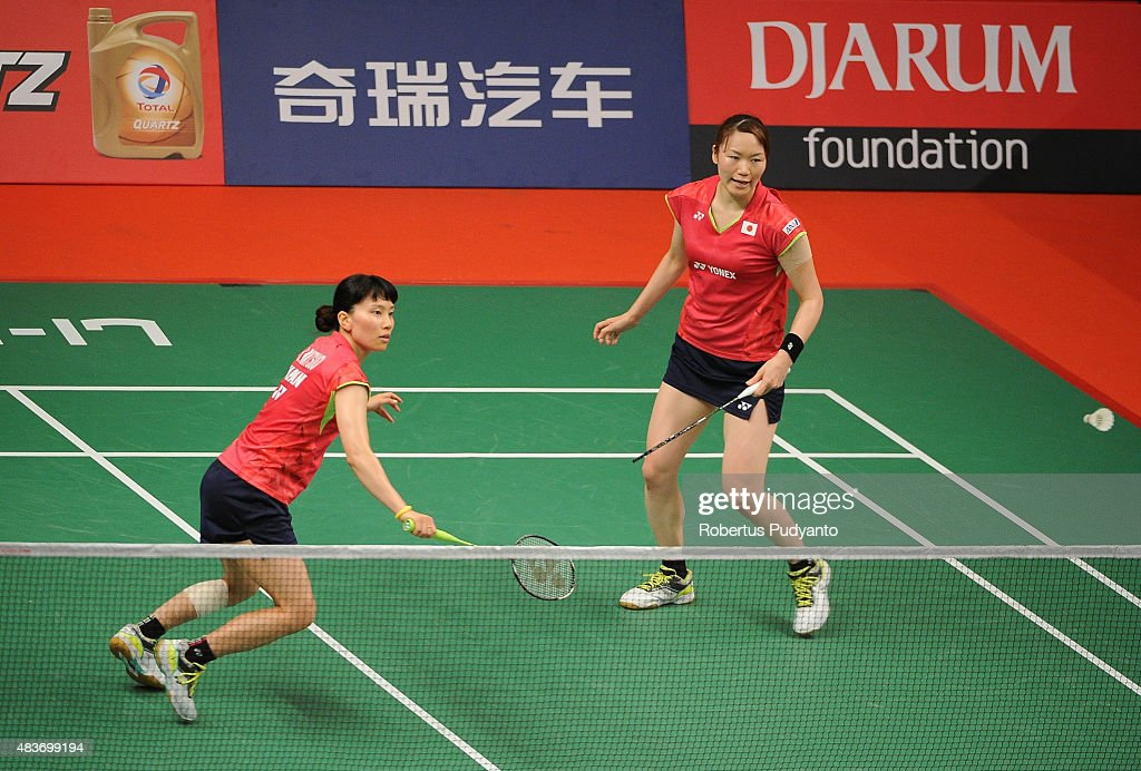 <a gi-track='captionPersonalityLinkClicked' href=/galleries/search?phrase=Shizuka+Matsuo&family=editorial&specificpeople=6139702 ng-click='$event.stopPropagation()'>Shizuka Matsuo</a> and <a gi-track='captionPersonalityLinkClicked' href=/galleries/search?phrase=Mami+Naito&family=editorial&specificpeople=7151819 ng-click='$event.stopPropagation()'>Mami Naito</a> of Japan compete against Pradnya Gadre and Sikki N. Reddy of India in the 2015 Total BWF World Championship at Istora Senayan on August 12, 2015 in Jakarta, Indonesia.