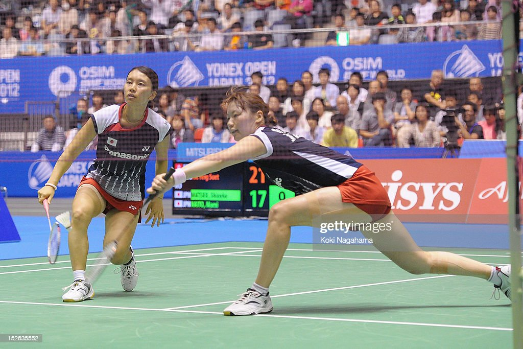<a gi-track='captionPersonalityLinkClicked' href=/galleries/search?phrase=Shizuka+Matsuo&family=editorial&specificpeople=6139702 ng-click='$event.stopPropagation()'>Shizuka Matsuo</a> and <a gi-track='captionPersonalityLinkClicked' href=/galleries/search?phrase=Mami+Naito&family=editorial&specificpeople=7151819 ng-click='$event.stopPropagation()'>Mami Naito</a> of Japan compete the women's doubles final match against Ying Suet Tse and Lok Yan Poon of Hong Kong China during day five of the Yonex Open Japan 2012 at Yoyogi Gymnasium on September 23, 2012 in Tokyo, Japan.