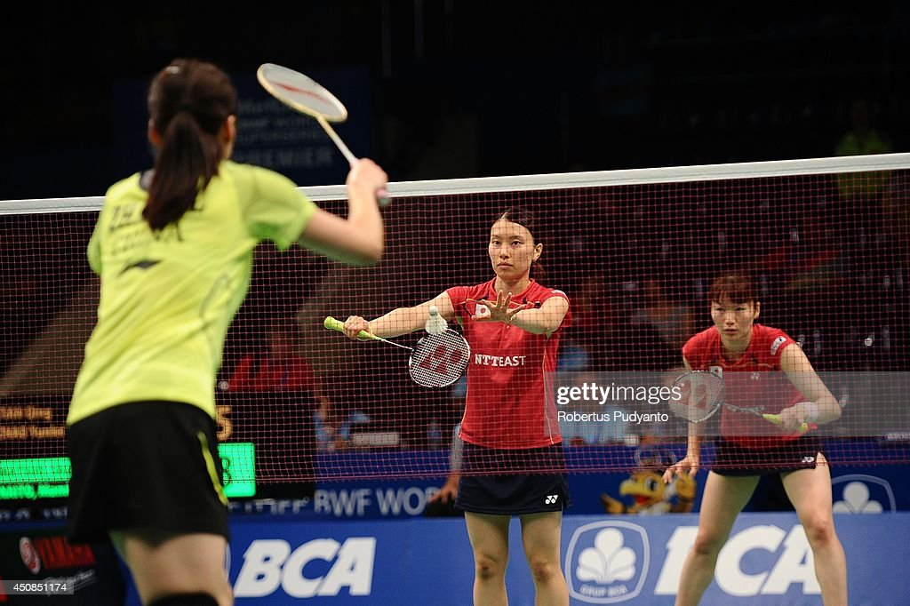 <a gi-track='captionPersonalityLinkClicked' href=/galleries/search?phrase=Shizuka+Matsuo&family=editorial&specificpeople=6139702 ng-click='$event.stopPropagation()'>Shizuka Matsuo</a> and <a gi-track='captionPersonalityLinkClicked' href=/galleries/search?phrase=Mami+Naito&family=editorial&specificpeople=7151819 ng-click='$event.stopPropagation()'>Mami Naito</a> of Japan return a shot against Tian Qing and Zhao Yunlei of China during the BCA Indonesia Open 2014 MetLife BWF World Super Series Premier at Istora Gelora Bung Karno Stadium on June 19, 2014 in Jakarta, Indonesia.