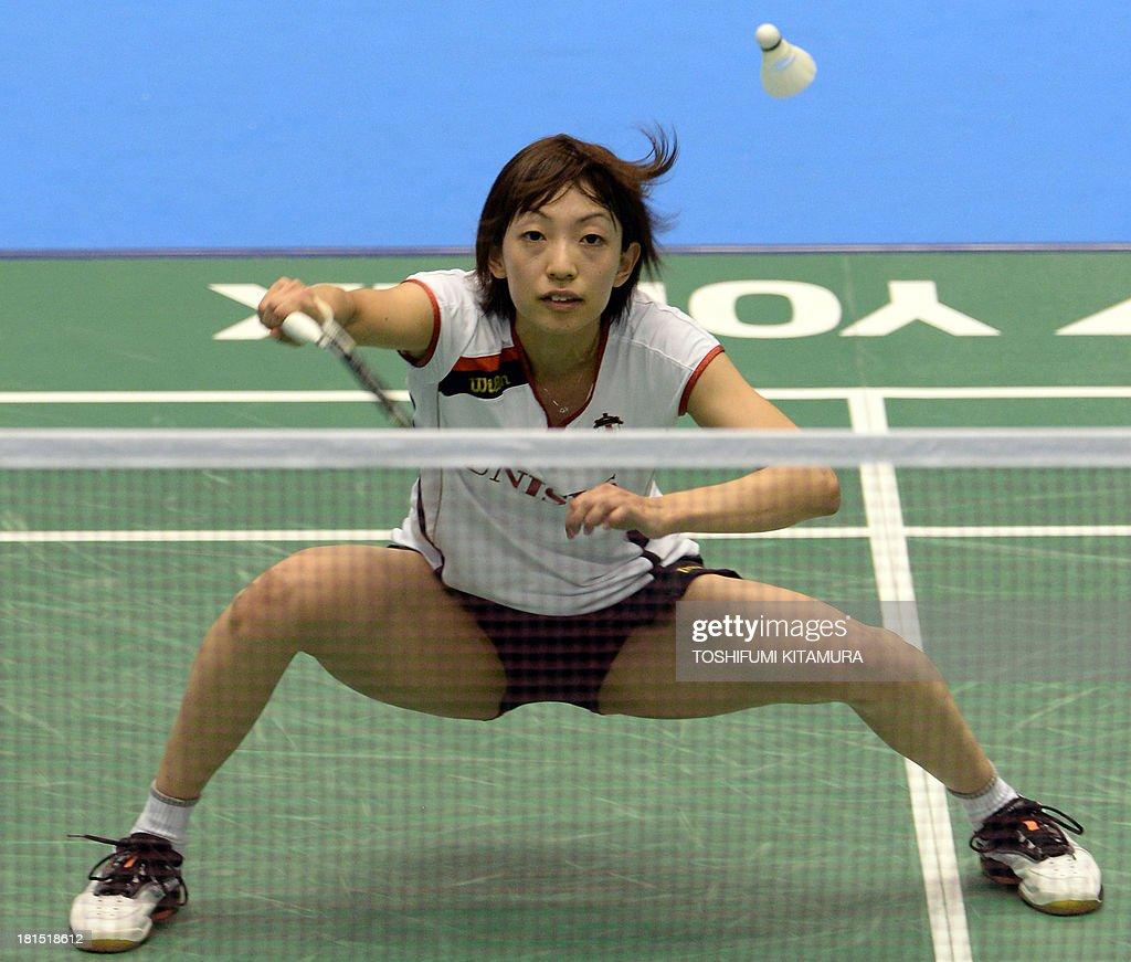 Shizuka Uchida of Japan hits a return during her women s singles