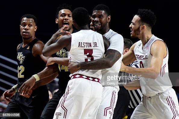 Shizz Alston Jr #3 is held back by Mark Williams of the Temple Owls after Matt Williams made contact as Nick Banyard of the UCF Knights instigates...
