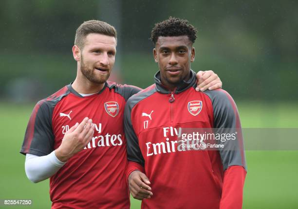 Shkodran Mustafi and Alex Iwobi of Arsenal during a training session at London Colney on August 2 2017 in St Albans England