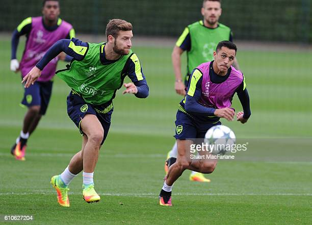 Shkodran Mustafi and Alexis Sanchez of Arsenal during a training session at London Colney on September 27 2016 in St Albans England