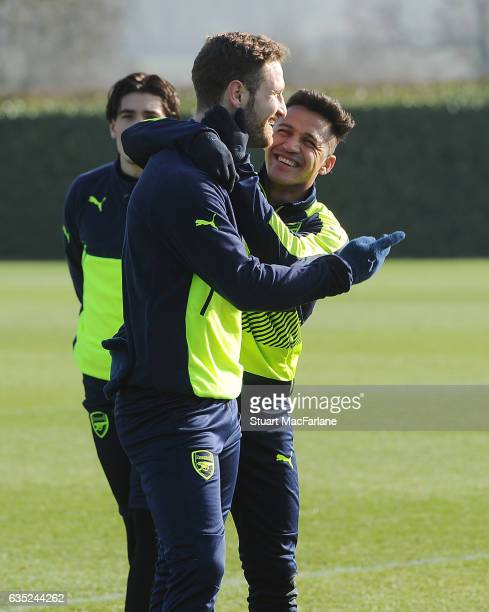 Shkodran Mustafi and Alexis Sanchez of Arsenal during a training session at London Colney on February 13 2017 in St Albans England