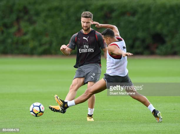 LR0 Shkodran Mustafi and Alexis Sanchez of Arsenal during a training session at London Colney on August 18 2017 in St Albans England