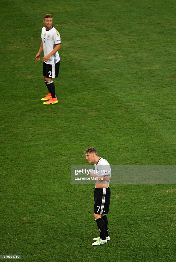 Shkodran Mustafi (top) and Bastian Schweinsteiger (bottom) of Germany react after France's second goal during the UEFA EURO semi final match between Germany and France at Stade Velodrome on July 7, 2016 in Marseille, France.