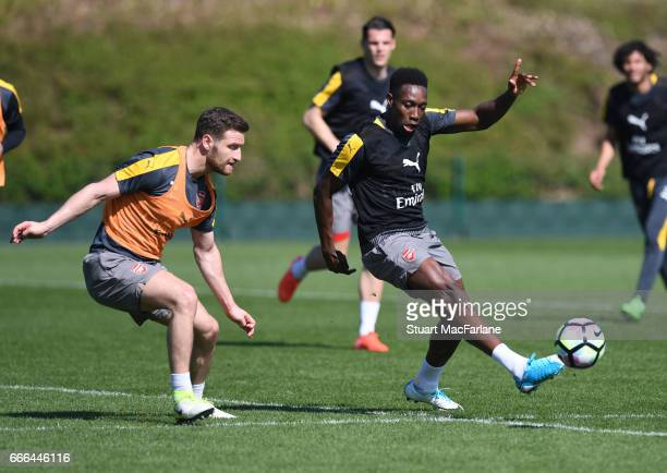 Shkodran Mustafi and Danny Welbeck of Arsenal during a training session at London Colney on April 9 2017 in St Albans England