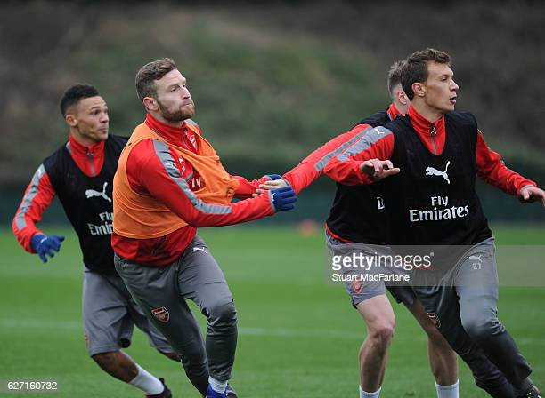 Shkodran Mustafi and Krystian Bielik of Arsenal during a training session at London Colney on December 2 2016 in St Albans England