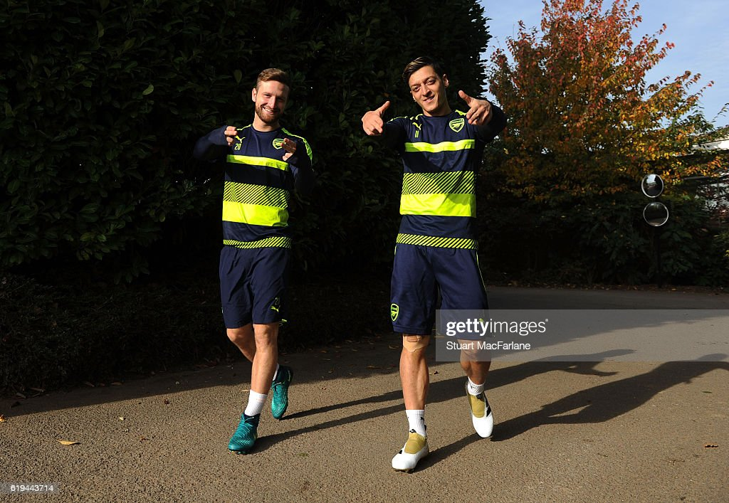 Shkodran Mustafi and Mesut Ozil of Arsenal during a training session at London Colney on October 31, 2016 in St Albans, England.