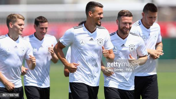 Shkodran Mustafi and Sandro Wagner chat during a Germany training session at Sotchi Parc Arena ahead of their FIFA Confederations Cup Russia 2017...