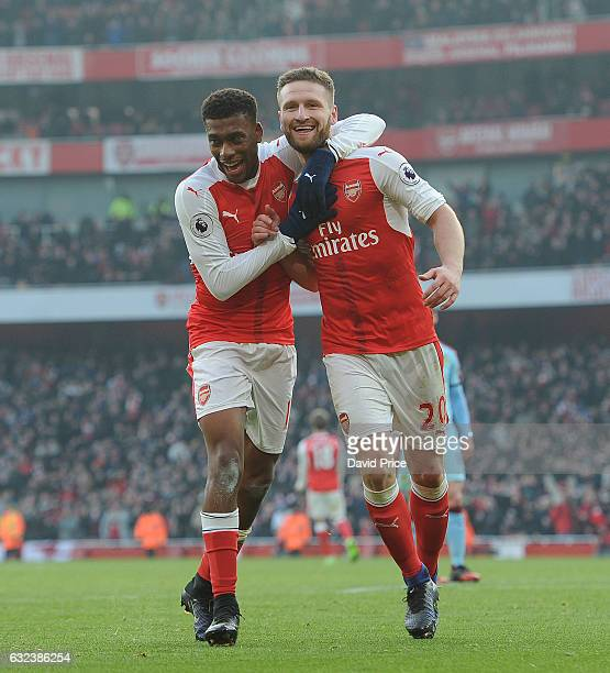 Shkodran Mustafi celebrates scoring a goal for Arsenal with Alex Iwobi during the Premier League match between Arsenal and Burnley at Emirates...