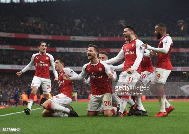 Shkodran Mustafi celebrates scoring the 1st Arsenal goal with Granit Xhaka Sead Kolasinac and Alex Lacazette during the Premier League match between...