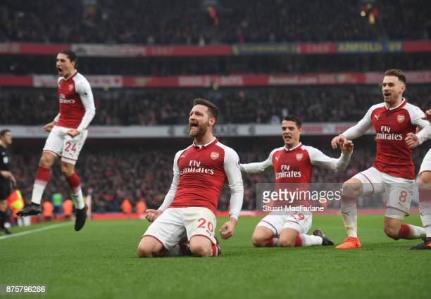 Shkodran Mustafi celebrates scoring the 1st Arsenal goal with Granit Xhaka and Aaron Ramsey during the Premier League match between Arsenal and...
