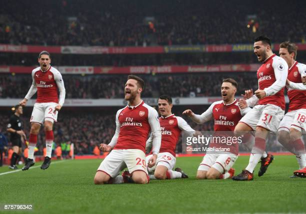 Shkodran Mustafi celebrates scoring the 1st Arsenal goal with Granit Xhaka Aaron Ramsey and Sead Kolasinac during the Premier League match between...