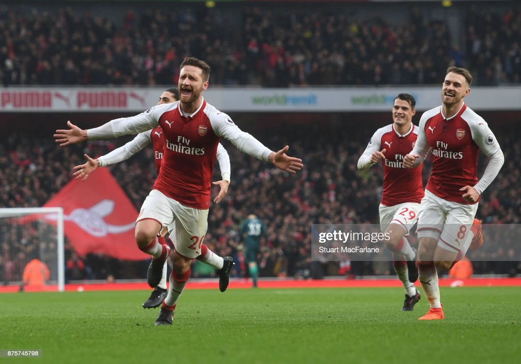 Shkodran Mustafi celebrates scoring the first Arsenal goal with (R) Aaron Ramsey during the Premier League match between Arsenal and Tottenham Hotspur at Emirates Stadium on November 18, 2017 in London, England.