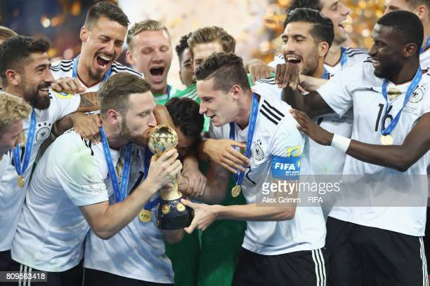 Shkodran Mustafi Julian Draxler and team mates of Germany celebrate with the trophy after the FIFA Confederations Cup Russia 2017 final between Chile...