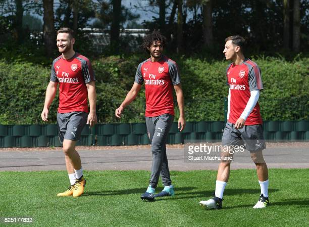 Shkodran Mustafi Mohamed Elneny and Mesut Ozil of Arsenal during a training session at London Colney on August 1 2017 in St Albans England