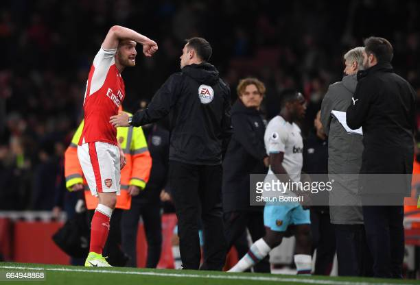 Shkodran Mustafi of Arsenal argues with the fourth offical during the Premier League match between Arsenal and West Ham United at the Emirates...