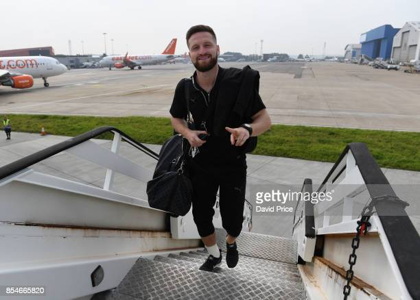 Shkodran Mustafi of Arsenal boards the plane at Luton Airport on September 27 2017 in Luton England