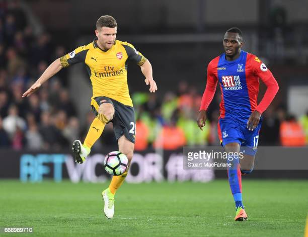 Shkodran Mustafi of Arsenal breaks past Christian Benteke of Crystal Palace during the Premier League match between Crystal Palace and Arsenal at...