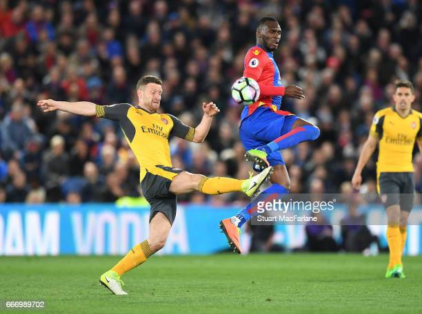 Shkodran Mustafi of Arsenal challenges Christian Benteke of Crystal Palace during the Premier League match between Crystal Palace and Arsenal at...