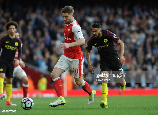 Shkodran Mustafi of Arsenal challenges Gael Clichy of Manchester City during the Premier League match between Arsenal and Manchester City at Emirates...