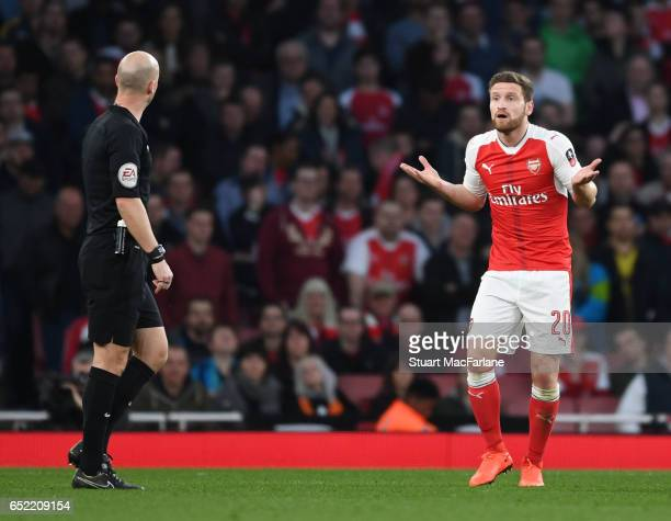 Shkodran Mustafi of Arsenal complains to referee Anthony Taylor during the Emirates FA Cup QuarterFinal between Arsenal and Lincoln City at Emirates...