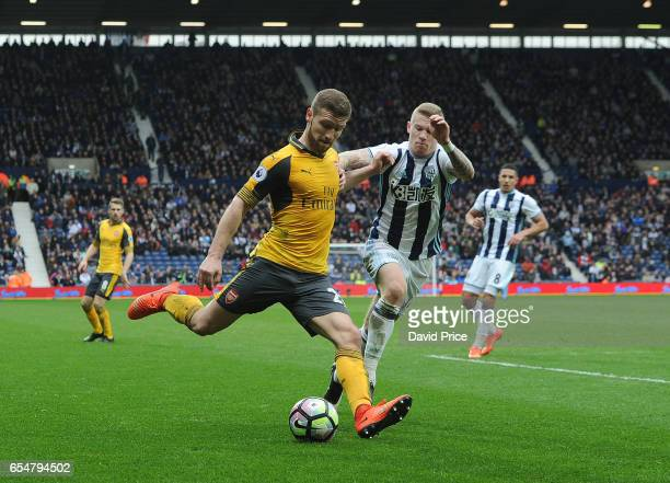 Shkodran Mustafi of Arsenal crosses the ball under pressure from James McClean of WBA during the Premier League match between West Bromwich Albion...