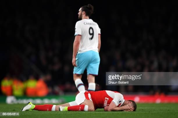 Shkodran Mustafi of Arsenal goes down injured during the Premier League match between Arsenal and West Ham United at the Emirates Stadium on April 5...