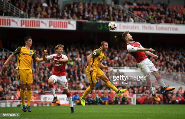 Shkodran Mustafi of Arsenal heads the ball away from Glenn Murray of Brighton and Hove Albion during the Premier League match between Arsenal and...