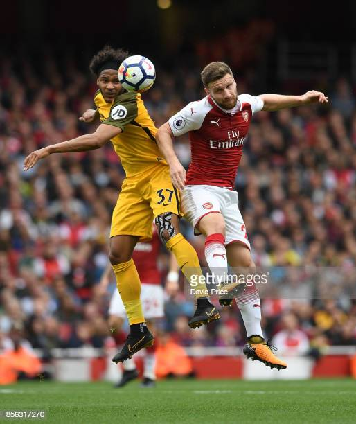 Shkodran Mustafi of Arsenal heads the ball away from Isaih Brown of Brighton during the Premier League match between Arsenal and Brighton and Hove...