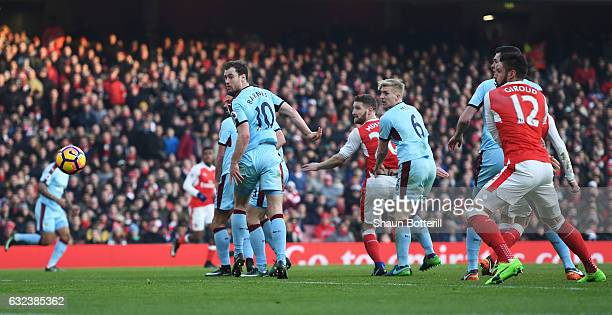 Shkodran Mustafi of Arsenal heads to score the opening goal during the Premier League match between Arsenal and Burnley at the Emirates Stadium on...