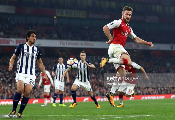 Shkodran Mustafi of Arsenal is watched by Ahmed ElSayed Hegazi of West Bromwich Albion during the Premier League match between Arsenal and West...