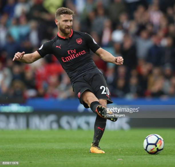 Shkodran Mustafi of Arsenal passes the ball during the Premier League match between Stoke City and Arsenal at Bet365 Stadium on August 19 2017 in...
