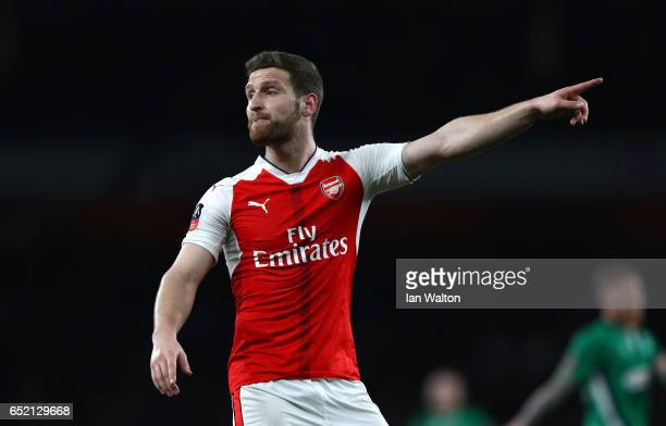 Shkodran Mustafi of Arsenal points during The Emirates FA Cup QuarterFinal match between Arsenal and Lincoln City at Emirates Stadium on March 11...