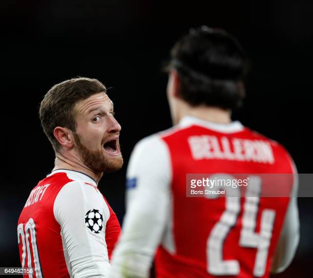 Shkodran Mustafi of Arsenal reacts with Hector Bellerin of Arsenal during the UEFA Champions League Round of 16 second leg match between Arsenal FC...