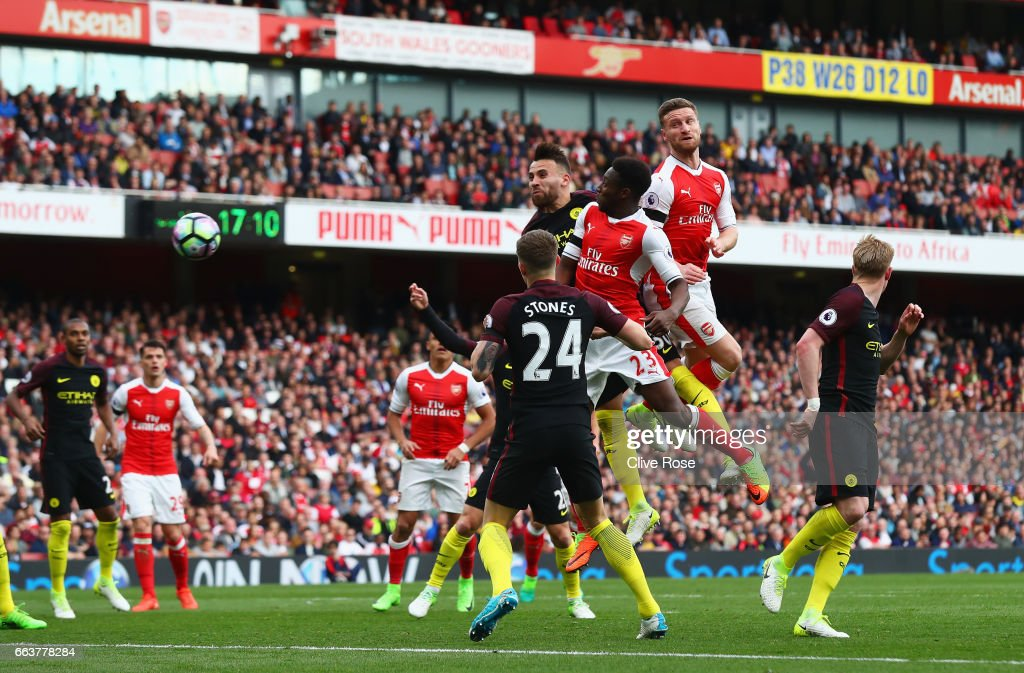 Shkodran Mustafi of Arsenal scores his sides second goal during the Premier League match between Arsenal and Manchester City at Emirates Stadium on April 2, 2017 in London, England.