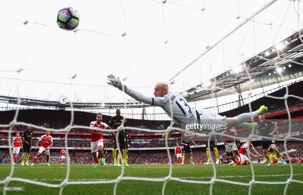 Shkodran Mustafi of Arsenal (R/obscure) scores his sides second goal past Willy Caballero of Manchester City (C) during the Premier League match between Arsenal and Manchester City at Emirates Stadium on April 2, 2017 in London, England.
