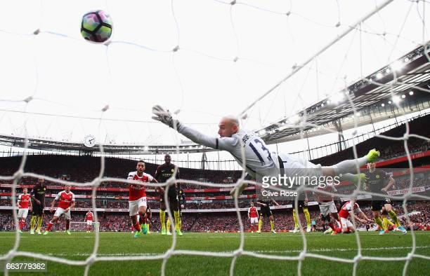 Shkodran Mustafi of Arsenal scores his sides second goal past Willy Caballero of Manchester City during the Premier League match between Arsenal and...