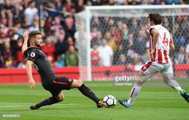 Shkodran Mustafi of Arsenal tackles Joe Allen of Stoke during the Premier League match between Stoke City and Arsenal at Bet365 Stadium on August 19...